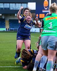 Caryl Thomas of Worcester Warriors Women and her team mate celebrate the home side's opening try - Mandatory by-line: Nick Browning/JMP - 20/12/2020 - RUGBY - Sixways Stadium - Worcester, England - Worcester Warriors Women v Harlequins Women - Allianz Premier 15s