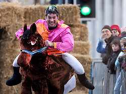 """© under licence to London News Pictures 28/11/2010 today picture. Birmingham`s wackiest Christmas event, the annual Pantominme Horse Grand National. The event that sees riders and horses race up and down Broad Street in the City Centre jumping over and even Through straw bales. Picture shows Joel Hicks on his horse """"Viagra"""" who came last in his race..Picture credit: Dave Warren/London News Pictures..."""