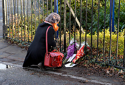 © Licensed to London News Pictures. 19th December 2014. Essex, UK. Flowers being placed at the scene of the murder of an 18 year old male who was fatally stabbed yesterday at the Chelmsford Museum, Oaklands Park, Moulsham Street, Chelmsford. Two males aged 17 and 19 have been arrested in relation to this matter and remain in custody. Photo credit : Simon Ford/LNP