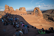 Crowds await sunset at Delicate Arch, utah. Picture by Andrew Tobin.