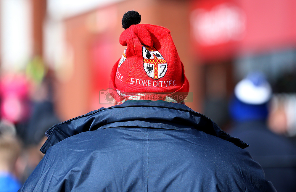 A Stoke City fan wears a hat to show their support
