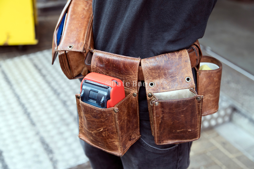 bar waiter with a leather waist belt for carrying the tools of his trade
