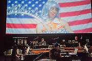 Brooklyn, NY - 20 January 2015. The dress rehearsal of Sufjan Stevens' Round-Up, with slow motion film of the Pendleton, Oregon Round-Up by Aaron and Alex Craig, music performd by Sufjan Stevens and Yarn/Wire. Musicians (L to R) Ning Yu (piano), Russell Greenberg, Sufjan Stevens (in the blue cap), Ian Antonio.