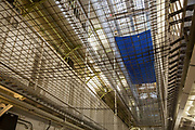 Upward view of the Wing Levels in Her Majesty's Prison Pentonville, London, United Kingdom. <br /> Pentonville is a local prison and holds Category B and C males and A Wing is for this who are on remand and convicted. The prison was built in 1816 as a modern prison and was uniquely designed for rehabilitation.  It was the first radial design prison which allowed staff to view all 5 wings from the central hall. The prison remains largely untouched from its original design, however netting has been added across the levels to prevent suicide. (Photo by Andy Aitchison)