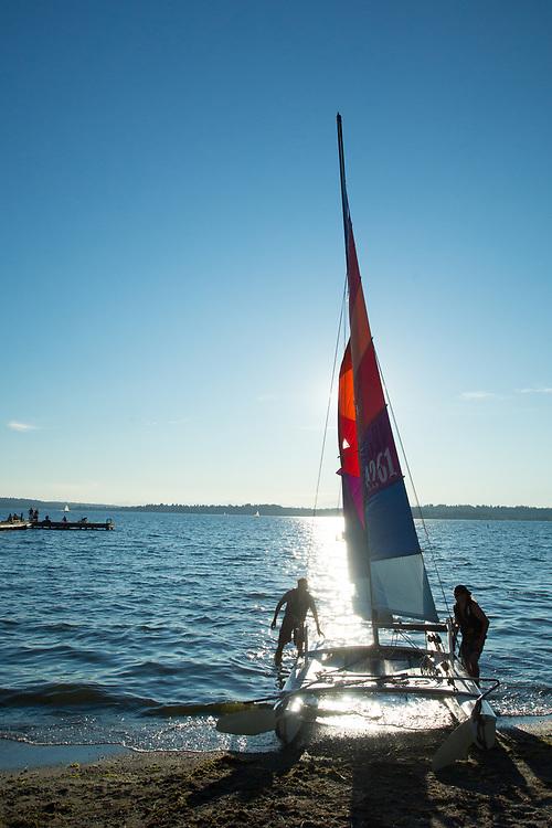 United States, Washington, Kirkland,  sailboat on beach on Lake Washington
