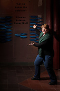 Jennifer Pictou, bead artist and Tribal Historic Preservation Officer for the Aroostook Band of Micmacs, in front of the Mi'kmaq Veterans Honor Wall at the Micmac Cultural Center, Presque Isle. Ms. Pictou worked on research and grant-writing for four years to bring the Honor Wall to life. It is the first formal list of Mi'kmaq veterans and has evolved to include an oral history component. Ms. Pictou is the owner of Bar Harbor Ghost Tours, and has served as Curator of Education at the Abbe Museum and as Executive Director of the Bangor Museum and Center for History.