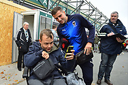 Ben Purrington (3) of AFC Wimbledon having a photo with a fan on arrival at Home Park stadium before the EFL Sky Bet League 1 match between Plymouth Argyle and AFC Wimbledon at Home Park, Plymouth, England on 6 October 2018.