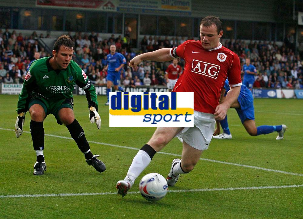 Photo: Glyn Thomas.<br /> Macclesfield Town v Manchester United. Pre Season Friendly. 31/07/2006.<br /> <br /> Manchester United's Wayne Rooney (R).