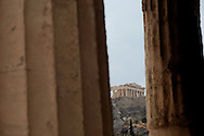 The Parthenon as seen through the pillars of the Temple of Hephaitos.  Photograph by Dennis Brack