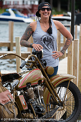 Jody Perewitz on the dock at the Naswa resort after MC'ing the annual bikini contest during Laconia Motorcycle Week. NH, USA. Thursday, June 14, 2018. Photography ©2018 Michael Lichter.