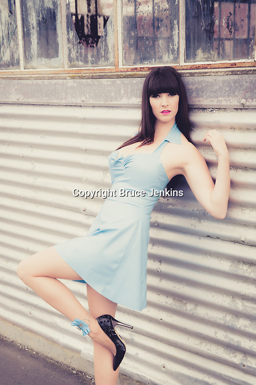 Model wearing blue latex dress