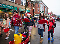 The Streetcar Company marchers singing carols through downtown during the Light Up Laconia Holiday Parade on Sunday.  (Karen Bobotas/for the Laconia Daily Sun)