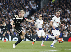 BRITAIN-LONDON-FOOTBALL-UEFA CHAMPIONS LEAGUE-TOTTENHAM HOTSPUR VS AJAX.(190430) -- LONDON, April 30, 2019  Ajax's Donny van de Beek (L) scoring the only goal of the game during the UEFA Champions League Semifinal First Leg match between Tottenham Hotspur and Ajax at The Tottenham Hotspur Stadium in London, Britain on April 30, 2019. Ajax won 1-0.  FOR EDITORIAL USE ONLY. NOT FOR SALE FOR MARKETING OR ADVERTISING CAMPAIGNS. NO USE WITH UNAUTHORIZED AUDIO, VIDEO, DATA, FIXTURE LISTS, CLUB/LEAGUE LOGOS OR ''LIVE'' SERVICES. ONLINE IN-MATCH USE LIMITED TO 45 IMAGES, NO VIDEO EMULATION. NO USE IN BETTING, GAMES OR SINGLE CLUB/LEAGUE/PLAYER PUBLICATIONS. (Credit Image: © Matthew Impey/Xinhua via ZUMA Wire)