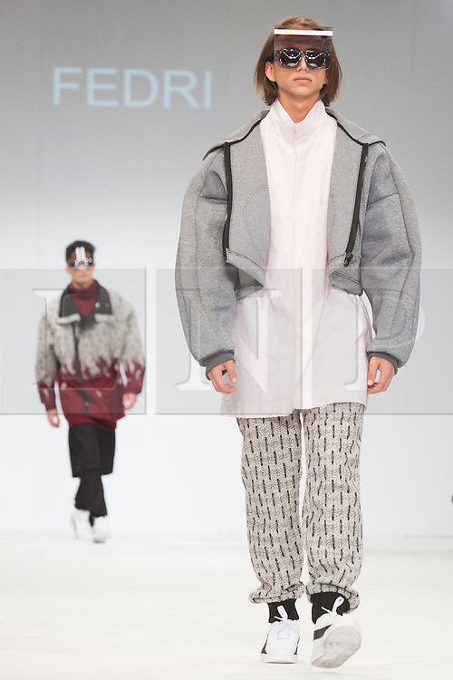 © Licensed to London News Pictures. 02/06/2015. London, UK. Collection by Fedri of NAFA. Samsonite International Catwalk Competition takes place during Graduate Fashion Week 2015. Graduate Fashion Week takes place from 30 May to 2 June 2015 at the Old Truman Brewery, Brick Lane. Photo credit : Bettina Strenske/LNP