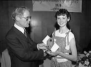 Young Dress Designer of the Year.     (M75).1979..22.05.1979..05.22.1979..22nd May 1979..The Cassidy Fabrics sponsored Young Dress Designer of the Year, make and model competition was held today in Liberty Hall,Dublin. The overall winner of the competition was Ms Marianne Byrne (15),Cabinteely,Co Dublin. Ms Byrne is a pupil at the Cabinteely Community School....Image shows Mr Michael Cassidy,Director Cassidy Fabrics, presenting an award to a section winner..Unfortunately we do not have her name, if you know her why not let us know at irishphotoarchive.ie