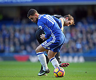 Chelsea's Eden Hazard tussles with WBA's Gareth McAuley during the Premier League match at Stamford Bridge Stadium, London. Picture date December 11th, 2016 Pic David Klein/Sportimage