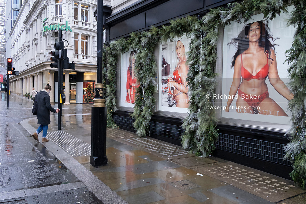 Four days before Christmas, womens' clothing retailer Victoria's Secret remains closed after the government's last-minute u-turn on the easing of Coronavirus pandemic rules. London and the South-East has been put under a Tier 4 restriction, forcing the closure of non-essential shops and small businesses, on 21st December 2020, in London, England.