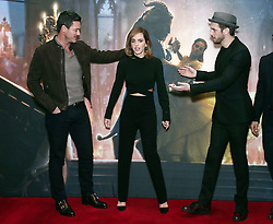 (left to right) Luke Evans, Emma Watson and Dan Stevens during a photo call with the cast of Beauty and the Beast, at The Corinthia Hotel, London.