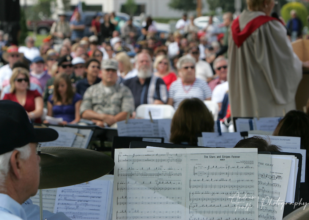 """/Andrew Foulk/ For the Californian/.The audience listens as the Temecula Valley Winds, play """"Stars and Stripes Forever"""" during the Lake Elsinore cemetery Memorial Day ceremony."""
