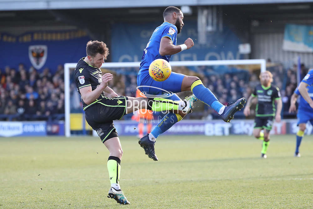 AFC Wimbledon midfielder Liam Trotter (14) tackling Bristol Rovers defender Joe Partington (22)  during the EFL Sky Bet League 1 match between AFC Wimbledon and Bristol Rovers at the Cherry Red Records Stadium, Kingston, England on 17 February 2018. Picture by Matthew Redman.