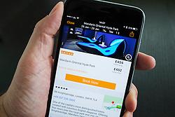 Kayak hotel booking app showing luxury London Hotel on iPhone 6 Plus smart phone