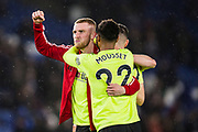 Oli McBurnie (Sheffield United) hugging Lys Mousset (Sheffield United) following the Premier League match between Brighton and Hove Albion and Sheffield United at the American Express Community Stadium, Brighton and Hove, England on 21 December 2019.