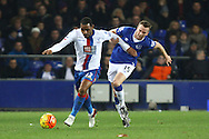 Jason Puncheon of Crystal Palace is held back by Tom Cleverley of Everton. Barclays Premier league match, Everton v Crystal Palace at Goodison Park in Liverpool, Merseyside on Monday 7th December 2015.<br /> pic by Chris Stading, Andrew Orchard sports photography.