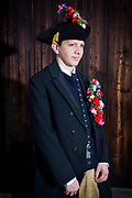 Lena, member of the Trachtengruppe Glasofen, is wearing a traditional bridal costume in Glasofen, Lower Franconia in Germany on March 4th, 2017.<br /> Fabian is wearing the traditional groom costume.<br /> <br /> The bridal crown and necklace are original and from 1860 and 1850. After the WWII, the association was formed and to preserve the traditional costumes, the members crafted original copies.<br /> Glasofen is part of the Wertheim Shire, an evangelical area surrounded by catholic Hinterland.<br /> <br /> This is part of the series about Traditional Wedding Gowns from different regions of Germany, worn by young members of local dance groups and cultural associations that exist to preserve and celebrate the cultural heritage. The portraiture series is a depiction of an old era with different social values and religious beliefs in an antiquated civil society with very few of those dresses left.