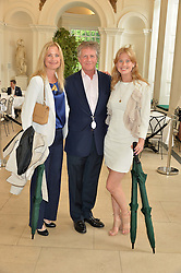 Left to right, BEN & LUCY SANGSTER nd their daughter ELIZA SANGSTER at the Goffs London Sale held at The Orangery, Kensington Palace, London on 12th June 2016.