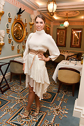 Amber Le Bon at an afternoon tea in honour of Megan Hess hosted by Lady Violet Manners at The Lanesborough, Hyde Park Corner, London, England. 10 November 2017.