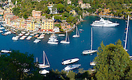 Harbour of Portofino . fashionable seaside fishing village for the wealthy .  Ligurian Coast. Italy .<br /> <br /> Visit our ITALY HISTORIC PLACES PHOTO COLLECTION for more   photos of Italy to download or buy as prints https://funkystock.photoshelter.com/gallery-collection/2b-Pictures-Images-of-Italy-Photos-of-Italian-Historic-Landmark-Sites/C0000qxA2zGFjd_k