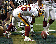 Washington Redskins running back Clinton Portis celebrates after scoring his second touchdown on the day against St. Louis, during the Redskins 24-9 win at the Edward Jones Dome in St. Louis, Missouri, December 4, 2005.