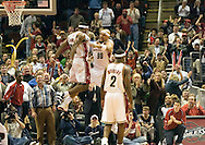 LeBron James and Drew Gooden celebrate a slam by LeBron.