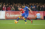 AFC Wimbledon defender Darius Charles (32) tackling Walsall forward Simeon Jackson (9) during the EFL Sky Bet League 1 match between AFC Wimbledon and Walsall at the Cherry Red Records Stadium, Kingston, England on 25 February 2017. Photo by Matthew Redman.