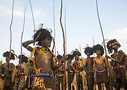 """The Time for Knives in Ethiopia<br /> <br /> The Dassanech live in southern Ethiopia. Dwelling in isolation along the Omo River, they have retained an ancestral way of life.<br /> They are called the """"People from the Delta"""" in relation to the neighboring Turkana Lake but their world is actually one of desert, dust and acacia trees. Add to this hostile environment the rampant presence of malaria. The Dassanech encompass eight clans. Each possesses magical powers, such as making fire, keeping snakes away or making it rain...<br /> <br /> <br /> The entire lives of the Dassanech revolve around their cattle, their only wealth. It provides meat, milk – which is essential during times of drought – and skins used as clothing and sleeping mats. The number of cows indicates their owner's social status. Despite their isolation, the Dassanech do not live in peace – their livestock remain under the threat of constant raids by the neighbouring tribes.<br /> <br /> And that is not folklore meant to impress the rare tourists who venture into these areas. Bloody clashes take place regularly, often with the Turkana tribe. Civil war is raging in southern Sudan nearby and Kalashnikovs sell for only $50. One only needs to take a look at the number of men with scars on their torsos, a sign that they have killed an enemy, to understand the ferocity of the fighting. There are hundreds of deaths every year. Kill a man and you will be a hero among the Dassanech.<br /> <br /> To become a man, one must go through the ceremony of the Dime. It takes place every year in June. It is the most important ritual in the lives of young Dassanech. This is the time for circumcision for boys and excision for girls. The time for knives, as the elders say.<br /> <br /> Testimonies about this ceremony are rare and for a good reason: the elders are reluctant to let foreigners attend the Dime. Even the few educated local Dassanech guides who live in the village of Omorate always come up with a good excuse not """