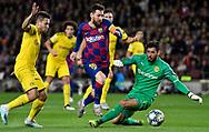 Leo Messi of FC Barcelona (center) dribbles Roman Burki goalkeeper  of Borussia Dortmundduring the Champions League match between FC Barcelona and Borussia Dortmund at Camp Nou Stadium on November 27,2019.