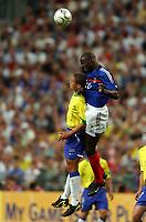 Fotball<br /> Foto: Dppi/Digitalsport<br /> NORWAY ONLY<br /> <br /> FIFA CENTENNIAL MATCH<br /> FRANKRIKE V BRASIL<br /> 20.05.2004<br /> <br /> LILIAN THURAM (FRA) / ALEX (BRA)