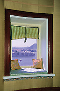 Jag Mandir palace viewed across Pichola Lake framed by a window in Shiv Niwas Palace, Udaipur. Rajasthan, India, 2002