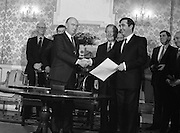 New Fianna Fáil Administration Sworn In.  (R52)..1987..10.03.1987..03.10.1987..10th March 1987..After their win in the recent general election the new Fianna Fáil government,under the leadershio of Charles Haughey, was sworn in and given their seals of offce at a ceremony in Áras an Uachtaráin today. The government received their seals from President Patrick Hillery...Attorney General, John Murray, is pictured receiving his certificate of office from President Hillery at the Arás today.