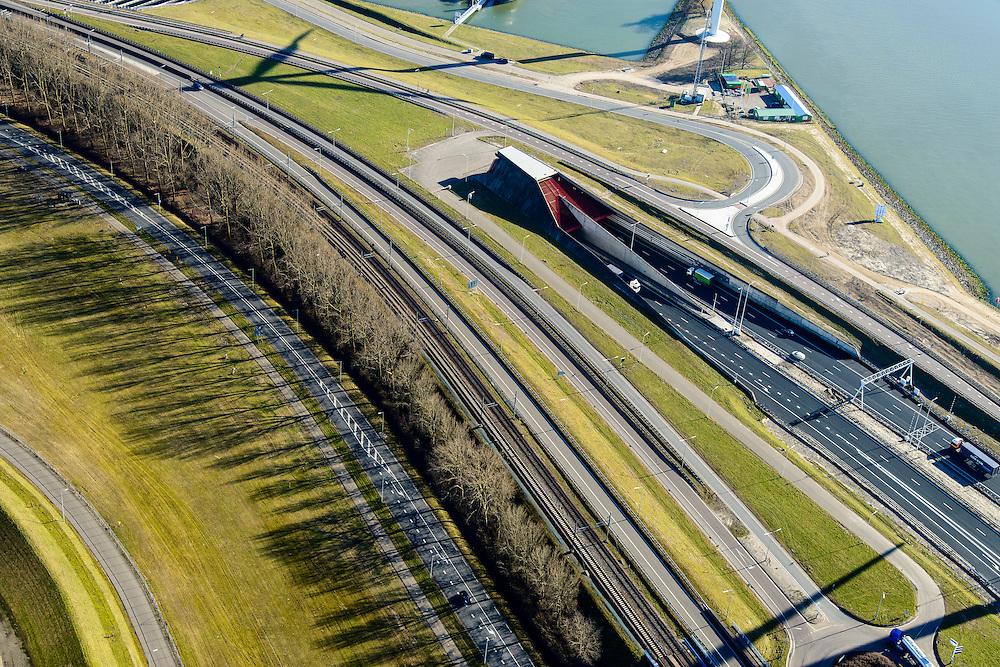 Nederland, Zuid-Holland, Rotterdam, 18-02-2015. A15, Burgemeester Thomassentunnel (Calandtunnel) onder Calandkanaal, gezien naar de Calandbrug.<br /> Motorway A15 with Caland tunnel, connecting Port of Rotterdam with hinterland.<br /> luchtfoto (toeslag op standard tarieven);<br /> aerial photo (additional fee required);<br /> copyright foto/photo Siebe Swart