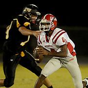 Jacksonville's Exelman Adams avoids Topsail's Trae Blanton.