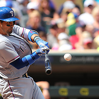MINNEAPOLIS, MN - JULY 02: Robinson Chirinos #61 of the Texas Rangers makes contact in the sixth inning against the Texas Rangers at Target Field on July 2, 2016 in Minneapolis, Minnesota. (Photo by Adam Bettcher/Getty Images) *** Local Caption *** Robinson Chirinos
