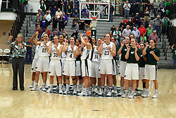 20 February 2016:  Titans celebrate at center court after a hard fought 5 point win on senior night during an NCAA women's basketball game between the Elmhurst Bluejays and the Illinois Wesleyan Titans in Shirk Center, Bloomington IL