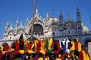 Jester hats for sale in the square of St. Mark's Basilica (Basilica di San Marco in Venezia), the most famous of the churches of Venice, Italy. The structure is one of the best examples of Byzantine architecture in the world. The building was also nicknamed Chiesa d'Oro ( church of gold ) due to it's lavish design and gilded Byzantine mosaics. The church dates back to 828 A.D and the basilica was consecrated in 1094 A.D...Subject photograph(s) are copyright Edward McCain. All rights are reserved except those specifically granted by Edward McCain in writing prior to publication...McCain Photography.211 S 4th Avenue.Tucson, AZ 85701-2103.(520) 623-1998.mobile: (520) 990-0999.fax: (520) 623-1190.http://www.mccainphoto.com.edward@mccainphoto.com.