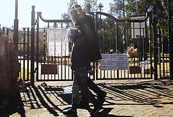 South Africa - Pretoria - 21 June 2020 - A father and son walks past a gate to the Union Buildings that has become a memorial to George Floyd and the Black Lives Matter movement.<br /> Picture: Jacques Naude/African News Agency(ANA)