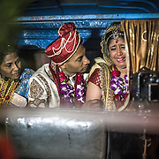 A Hindu groom consoles his weeping new wife as his mother looks on during their Vidaai in Goa. This couple had arranged an auto-rickshaw as their 'just-married' conveyance from the wedding venue to the reception hall at one of Goa's five star hotels. A funky twist to a luxury wedding.