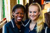 Train hostesses Zodwa Ndlovu and Sasha De Lange aboard the luxury Rovos Rail train from Pretoria to Cape Town, South Africa.