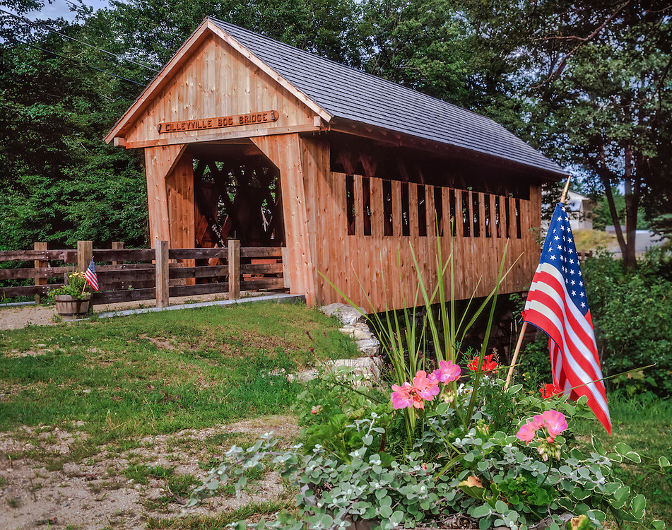 Cilleyville Bog Covered Bridge, planter with flowers & American flag, summer, Potter Place, NH