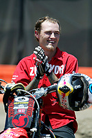 """Jul 01, 2003; Anaheim, California, USA; Moto X star athlete MIKE METZGER claps for fellow riders at the opening of Disney's California Adventure """"X Games Experience"""".  Disney park has built two X-Arena's specifically for this 41 day event highlighting extreme sports for the launch of the 2003 ESPN X Games.<br />Mandatory Credit: Photo by Shelly Castellano/Icon SMI<br />(©) Copyright 2003 by Shelly Castellano"""