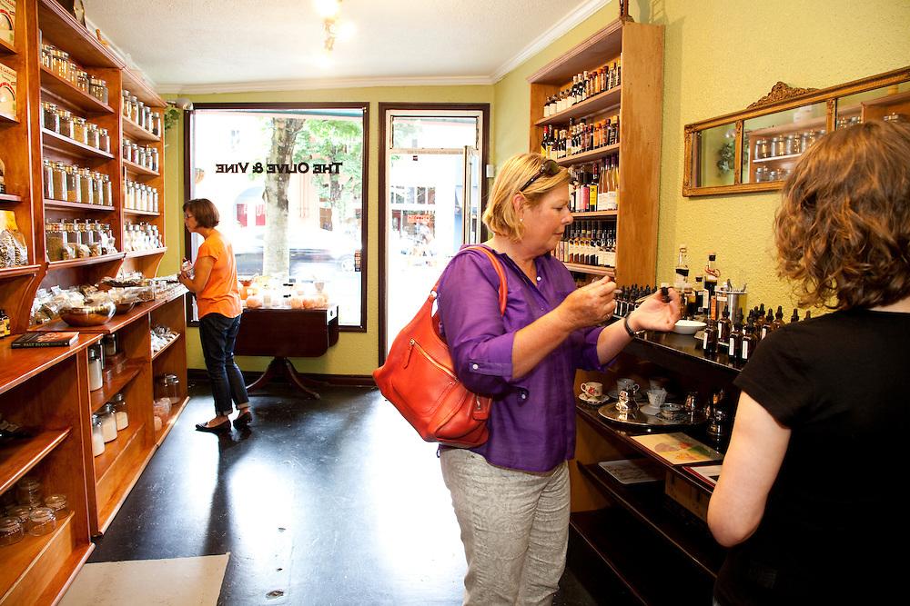 Shoppers at Olive and Vine in St. John's neighborhood, Portland Oregon. Olive and Vine offers gourmet salt, oil, vinegar, tea and spice